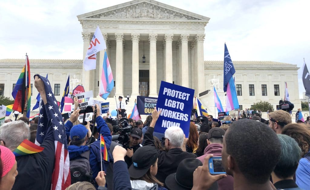 Protester crowd arouns the US Supreme Court building in support of LGBTQ rights